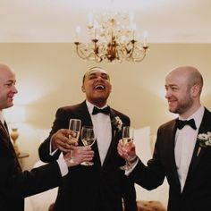 A simple black suit makes them look sharp and classic | Real Wedding: Gary Ireland and Gilbert Archuleta | Photo by: James Moes | Seattle Met Bride and Groom W/S 13