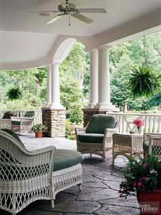 Carefully considered details in a covered patio can unify both your yard's hardscaping and your home's architectural details. This graceful space extends the curvy rooflines and columns as a tie to the house's expansive lines, while the dry-stack-like column bases and patio floor repeat hardscape elements found elsewhere. Matching wicker furniture (protected by the space) connects the decor pieces.