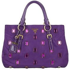 Prada www.hook-her.net Purse Hooks in Purple and other colours to keep your handbag clean.