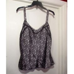NWT Ann Taylor Grey Silk Blouse Beautiful Ann Taylor blouse in a grey tone with black detailing on the print and black lace detailing. This blouse still has the tags attached and is a size 10. Willing to bundle different pieces  Ann Taylor Tops Blouses
