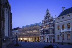 The new city hall in Deventer unites the old historical city hall with a new city office. The new building complex is located at the 'Grote Kerkhof' and exte...