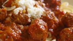 Big, tasty beef meatballs are simmered in an easy Italian tomato sauce in this easy recipe.