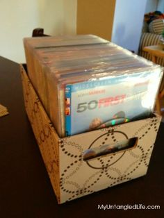 DVD Collection Organized in Cute Storage Box - save space and clutter for movie storage