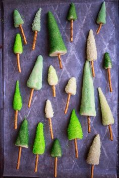 Le Frufrù:marzipan pine trees with pretzel trunks. These were made as cake toppers but it's a great idea for a gingerbread house, too