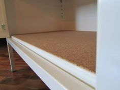 Adhesive Cork Shelf Liner on IKEA PS Cabinet - I'm going to get me some of these!!!
