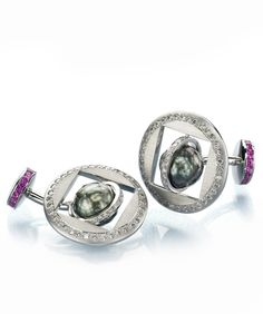 ORBIT CUFFLINKS    AJDC Design Project 2004 - Sphere, AGTA Spectrum Award 2005 – 1st Place, Men's Category  Rotating platinum cufflinks featuring two 11mm black south sea pearls and accented by 1.20ctw of pink sapphires and 1.61ctw of white diamonds.http://markschneiderdesign.com/jewelry/award-winning-jewelry/orbit-cufflinks