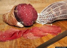 Bresaola...a cured Italian meat. It comes from beef rather than pork as does most cured meats...SO very flavorful!! Air-dried, salted, aged for months, it is soft and tender, lean and served thinly sliced, slightly chilled with antipasto, cheese and crusty Italian bread. Yum.