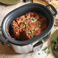 Feed a crowd with this flavor-packed lasagna, which cooks to bubbling perfection in a slow cooker.