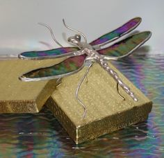 Iridescent turquoise dragonfly stained glass by Glassquirks