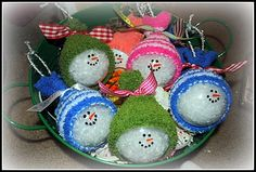 clear glass ornaments filled with fake snow, black sharpie paint pen, orange paint pen, hats were made using a baby sock cut a hole in the sock so you can attach string/ribbon