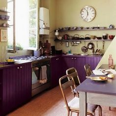 purple bottom cabinets with white knobs, grey 'cement' counters, glow-green waterproof (exterior paint?) walls with white or bamboo open shelves and/or dishracks. Cele mai frumoase bucătării [ I ]