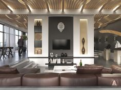 Like the last home, this gorgeous apartment features a recessed seating area that benefits from a white and black canvas. While the rich leather and warm golden lighting invoke a classical aesthetic, a few modern touches demonstrate a powerful contemporary personality, like the geometric papercraft Lion mount by Vova Baranyuk.