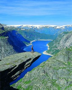 We've seen a lot of scary spots in Norway, but this is the hands-down scariest. It's called Trolltunga, and it's the edge of a cliff. Waaay back in the ice age, glacial water froze a hunk of this moun. Beautiful Places In The World, Great Places, Places To See, Troll, Visit Norway, Rio, Norway Travel, Fjord, Adventure Is Out There