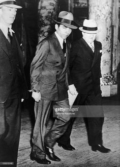 After Having Been Arrested For Drug Trafficking And Procuring, Charles 'Lucky' Luciano Is Led To The New York Courthouse On April 18, 1936.