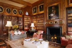 Library in Antony House, Cornwall, showing fireplace, bookcase, chairs and pine panelling