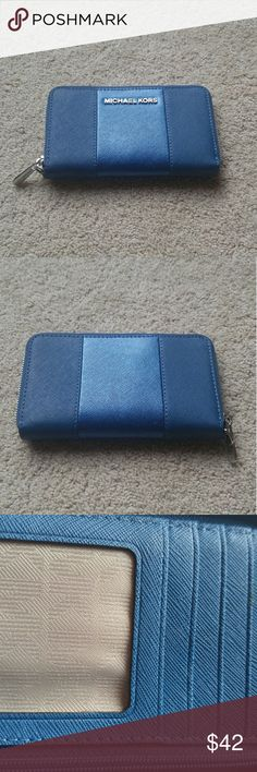 Michael Kors Wallet Hello. I am currently selling a Michael Kors Wallet. All the details are listed but feel free to ask questions or make offers. Generally reasonable offers are always accepted!:)  Brand: Michael Kors Authentic: Yes Color: Blue Card Slots: Yes ID Slot: Yes Cash Slot: Yes Closure: Zipper Condition: New Without Tags Michael Kors Bags Wallets