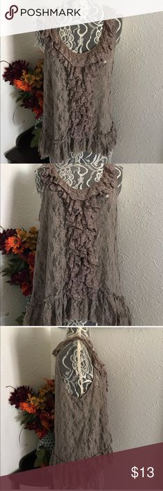 Brown Lace Top Great condition with no rips wholes or stains. It is see through. Loose fit. Tag on Shirt was removed due to seeing through Shirt. Tops Blouses