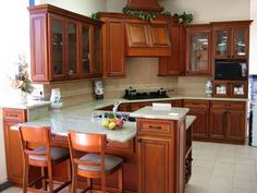 honey oak kitchen cabinets with black countertops | white cabinets