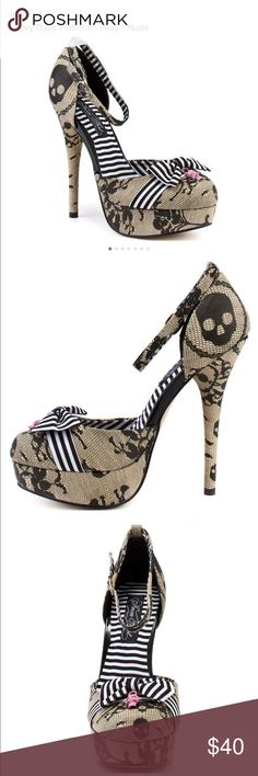 Iron Fist: Lacey Days Platform - Ivory / Nude Worn once like new. Lacey Days features a 5 inch heel with an ivory tone upper patterned with skulls and lace details. A closed toe 1 inch platform, striped white bow, and pink skull charm complete these adorable heels. Iron Fist Shoes Heels