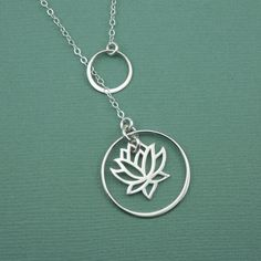 Lotus Lariat Necklace - sterling silver lotus pendant - yoga gift. $49.00, via Etsy.