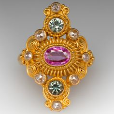 This Neda Behnam designed ring is crafted of warm yellow gold and adorned with pink and green sapphires alongside rose cut diamonds, all bezel set amongst the unique gold designs along the face of the ring. It's a beautiful piece and can be sized to fit. Ring Designs, Gold Designs, Diamond Tennis Necklace, Green Sapphire, Rose Cut Diamond, Yellow Gold Rings, Cocktail Rings, Pink And Green, Jewelry Design