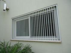 janela com grade clean