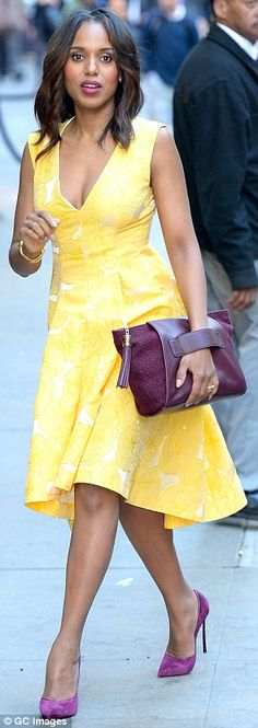 #datewear #streetstyle | Kerry Washington in a Giles yellow floral print midi dress with a plunging cleavage and a hi-low hem styled with an Allstate Foundation purple pouch and matching Casadei suede pumps