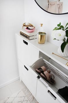 Home & Interior shoe storage cabinet in hallway with round mirror and area rug Is A Hidden Nanny Cam Hallway Shoe Storage, Ikea Shoe Cabinet, Hallway Cabinet, Hallway Mirror, Dark Hallway, Front Hallway, Shoe Rack Narrow Hallway, Narrow Cabinet Storage, Flat Hallway Ideas