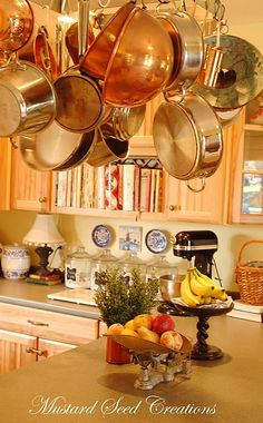 I have always wanted a hanging pot rack in my kitchen.  It would look great above a kitchen island.