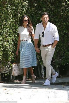 Pastels: The couple coordinated again as they headed to the meeting with Michelle showing off her tiny middle in a white lace crop top paired with a lace, prom-style skirt