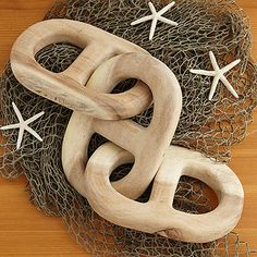 Hand carved wooden chain links. On sale won't be around long.