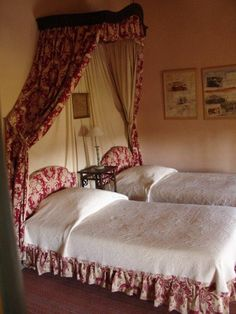 ~France. Love the headboard and dust ruffle treatment of the twin beds.