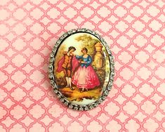 Vintage brooch with hand painted image of courting couple on porcelain with border of rhinestones, mid century by CardCurios on Etsy Hey Diddle Diddle, Carat Gold, Nursery Rhymes, Makers Mark, Vintage Brooches, Crystal Rhinestone, Rhinestones, Porcelain, Gift Wrapping