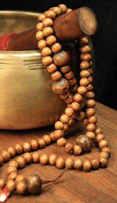 singing bowl and mala beads