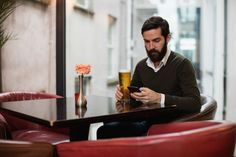 Man using mobile phone while having glass of beer #paid, , #AD, #sponsored, #mobile, #beer, #glass, #Man Photography Backdrop Stand, Used Mobile Phones, Backdrops, Beer, Glass, Root Beer, Ale, Drinkware, Corning Glass