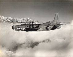 US Navy PB4Y-2 Privateer on patrol. This aircraft design was based on the B-24 Liberator but no super-charged engines and a tail design taken from the B-23 Dragon. The waist blisters seem to be inspired by the PBY Catalina. Date and location unknown.
