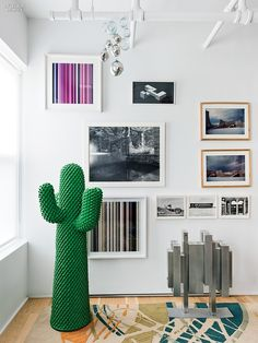 A Model Client: Federica Tondato's LES Loft | Projects | Interior Design - Its cactus coatrack by Guido Drocco and Franco Mello stands on Tondato's rug inspired by Lina Bo Bardi. Photography by Stephan Julliard. #design #interiordesign #interiordesignmagazine