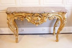 Console, Louis XV style in carved, gilded wood. Top in grey marble. 19th century. For sale on Proantic by Marc Segoura.