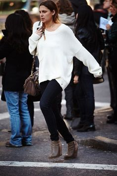 34 Winter Outfit Ideas: Glamour.com // Throw on a cream sweater with rugged brown accessories.