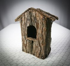 Example of a  Birdhouse Made of Tree Bark, ready for Decorating or Craft Project