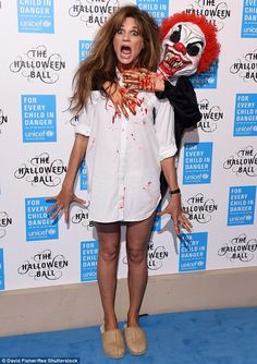 What a nightmare! Jemima Khan looks terrified as she accosted by an evil clown as she arrives at the UNICEF Halloween Ball in London on Thursday night