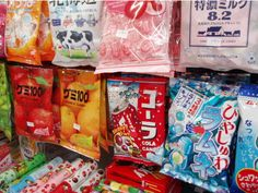 Japanese Candy OMG THE ORANGE ONES TO THR LEFT ARE AMAZING!!!!!! I love them so much!!! <3