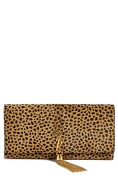 $1,950, Tan Leopard Suede Clutch: Saint Laurent Cassandre Calf Hair Clutch Or Noir. Sold by Nordstrom. Click for more info: https://lookastic.com/women/shop_items/114215/redirect