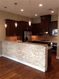Enchanting Stone Kitchen Ideas Bring Natural Feel Into Modern Homes Using stone materials for your kitchen walls are durable with unique texture and colors. Here are some stunning stone kitchen ideas to inspire you. Half Wall Kitchen, Stone Kitchen, New Kitchen, Kitchen Decor, Kitchen Ideas, Kitchen Walls, Kitchen Corner, Kitchen Island, Kitchen Wood