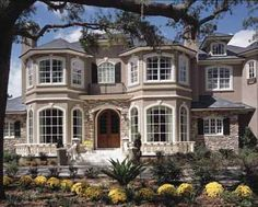 Love the bay windows, love the decorative porch, love the number of windows... love everything! exept the landscaping in this picture. That will have to go!  5 bedrooms; 5 1/2 baths, butler's pantry, wet bar, mud room, fireplace in master suite, excercise room; french doors....I could go on and on and on....