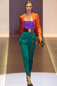 This outfit has triadic colors because the outfit consists of the three colors orange, purple and green that form a triangle on the color wheel.