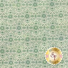 """Evergreen 30405-13 Evergreen by Moda Fabrics: Evergreen is a collection by BasicGrey for Moda Fabrics. This fabric features a green snowflake and floral design on a cream background. Width: 43""""/44""""Material: 100% CottonSwatch Size: 6"""" x 6"""" Expected Arrival Date Is May 2015"""