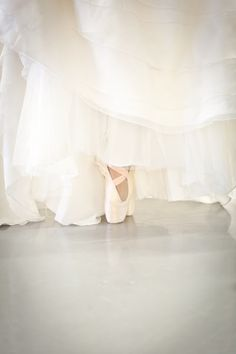 Wouldn't it be fun to have ballet shoes under a wedding dress?