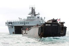 A Landing Craft Utility (LCU) of 4ASRM (4 Assualt Squadron Royal Marines) returns to HMS Bulwark in the English Channel, during the security operation for the Olympic Games.