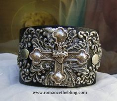 Black leather cuff with a handsilvered Maltese Cross and Sacred Heart focal piece. An original, OOAK design by Romancing the Bling  $95